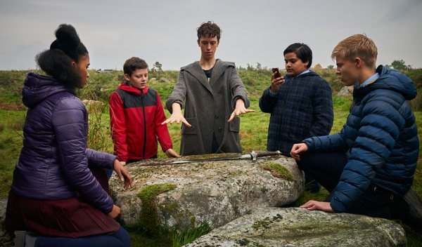 The kids watch Merlin ready to duplicate Excalibur