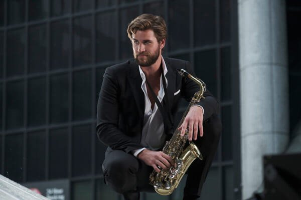 Blake plays sax in a fantasy dance sequence