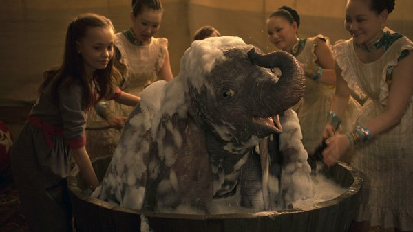 Milly and circus performers bathe Dumbo