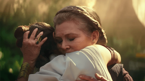 Carrie Fisher's General Leia embracing Rey