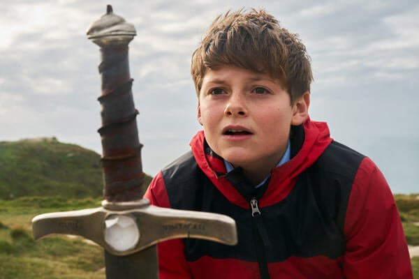 Alex (Louis) pulls Excalibur from the stone