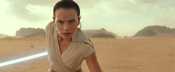 Rey with Luke Skywalker's blue lightsaber
