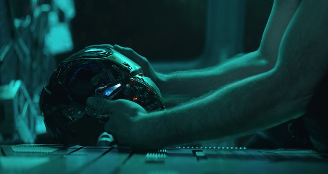 Tony Stark with his trashed Iron Man mask