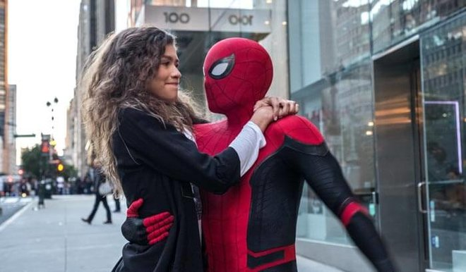 MJ (Zendaya) catches a ride from Spider-Man