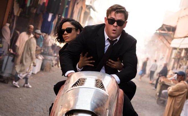 Chris Hemsworth as, H with Tessa Thompson, as Em in Marrakech