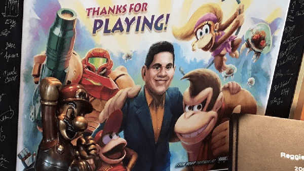 Reggie's going away card from Retro teased a tiny new character in the bottom left corner.