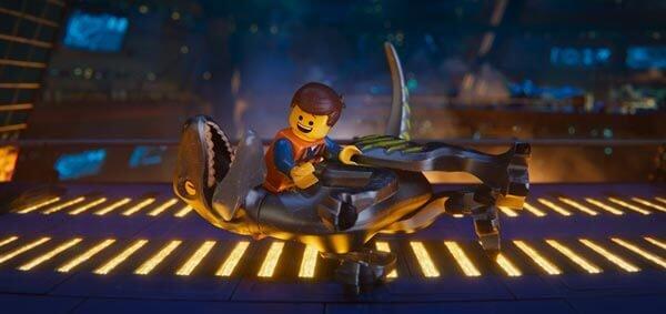 Emmet plays with Rex's raptor