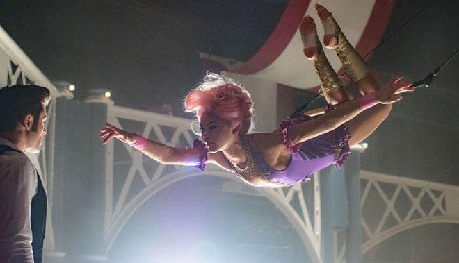 Phillip (Zac Efron) first falls for aerialist Anne (Zendaya) in The Greatest Showman