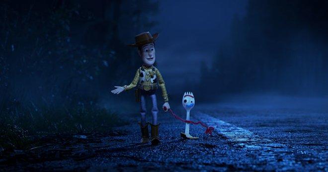 Woody and Forky walk toward the RV Park