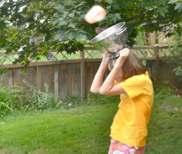Be creative with water balloons--Try a colander water balloon toss.