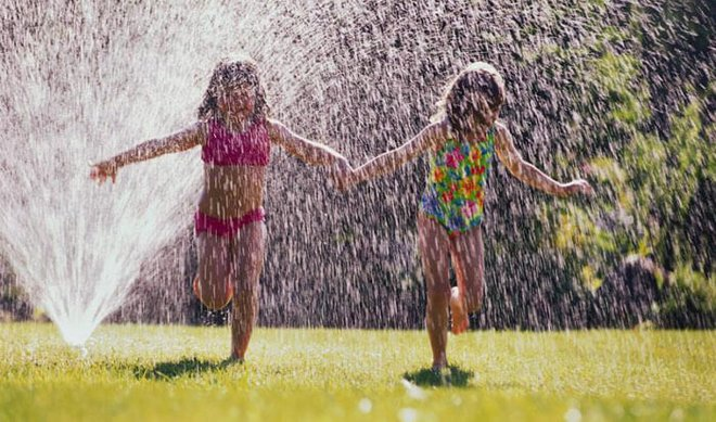 Create a sprinkler obstacle course using hula hoops and other things around the house.