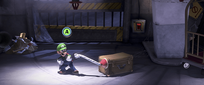 Luigi using the Suction Shot to move an obstacle